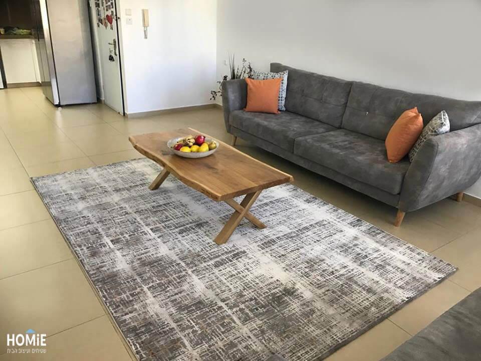 שטיח אבסטרקטי לסלון בצבע אפור וכתום דגם סיישל