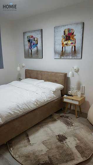 שטיח אבסטרקטי עגול בצבע חום ובז' דגם ג'נסיס